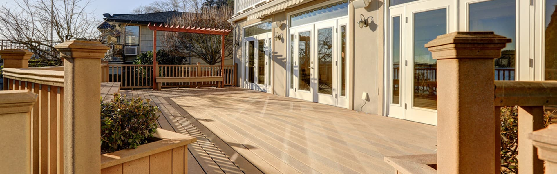 A wide view of a home deck in the morning light